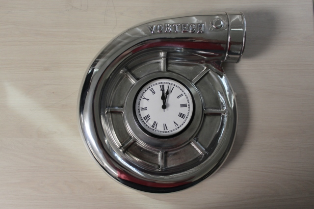Vortech Volute Clock in Polished Finish