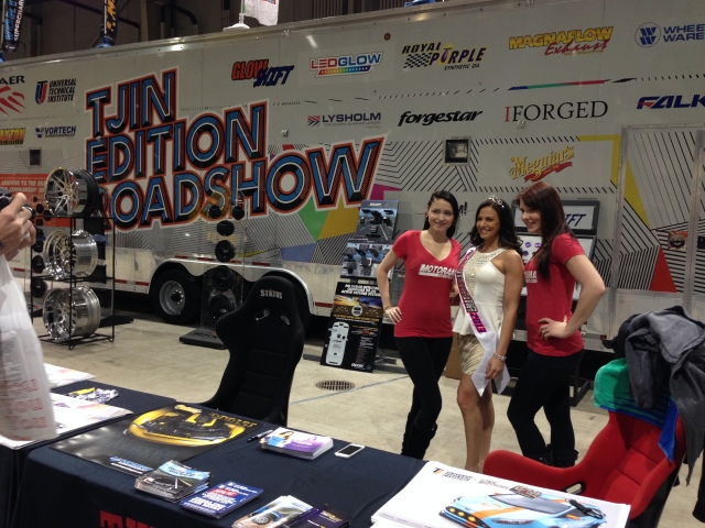Miss Motorama and her girls posing in the Tjin Edition Roadshow Booth